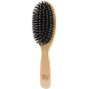Oval brush with mixed bristles